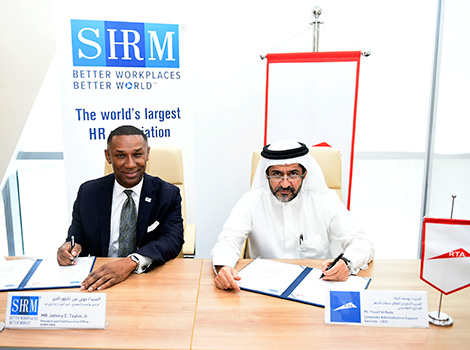 an image while Signing MoU with Society for Human Resource Management to improve training