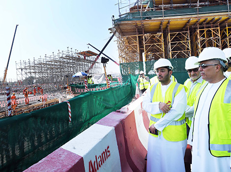 an image of Al Tayer inspecting works in the Project
