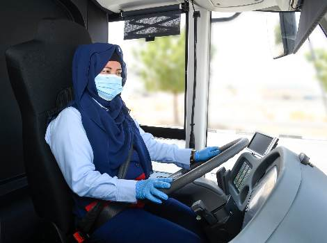 an image of RTA female bus driver