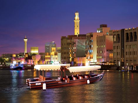 an image of Dubai's historic quarters and towering skyline, all in a relaxing cruise.