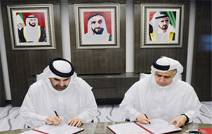 Al Tayer and Bin Huwaireb signing the MoU