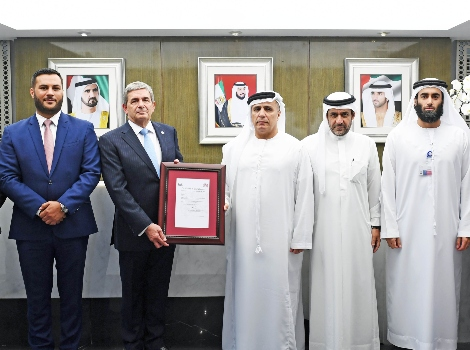 an image of Al Tayer receiving the ISO Certificate