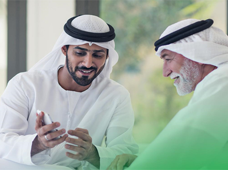 an image of an Emiratis, Senior using smart mobile