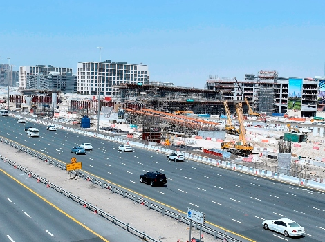 an image of work progressing fast in the construction of bridges leading to Dubai Hills Mall