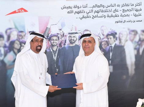 an image of Al Tayer and Al Shaibani signing the agreement