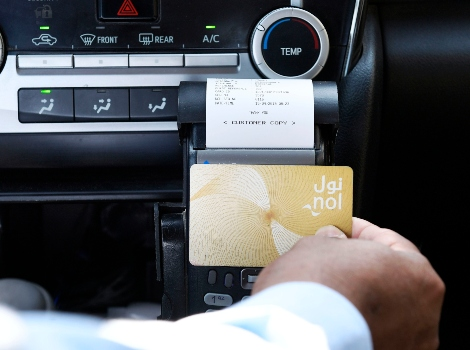 an image of easy payment of Taxi fare using nol card