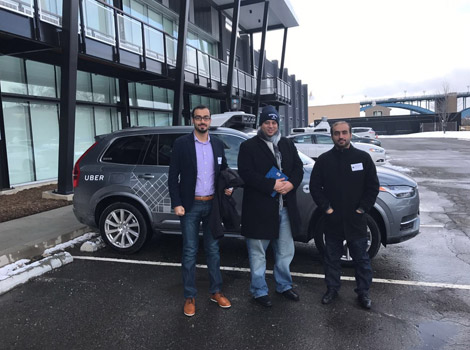 RTA's delegation beside one of Uber's driverless vehicle.