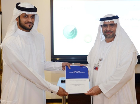 Image of Abdulla Al Madani awarding a certificate during Secure your Information workshop