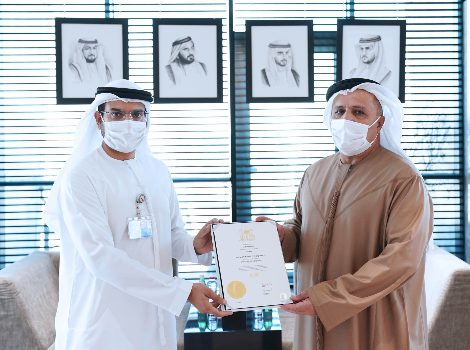 an image of Al Tayer with one of the graduates