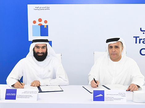 An image of Al Tayer and Al Falasi signing the MoU